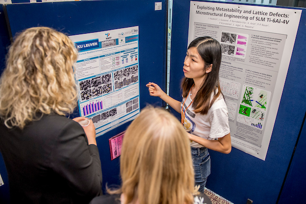 A discussion between three people at the Alloys for Additive Manufacturing Symposium [AAMS2018] poster session - A discussion between three people at the Alloys for Additive Manufacturing Symposium [AAMS2018] poster session