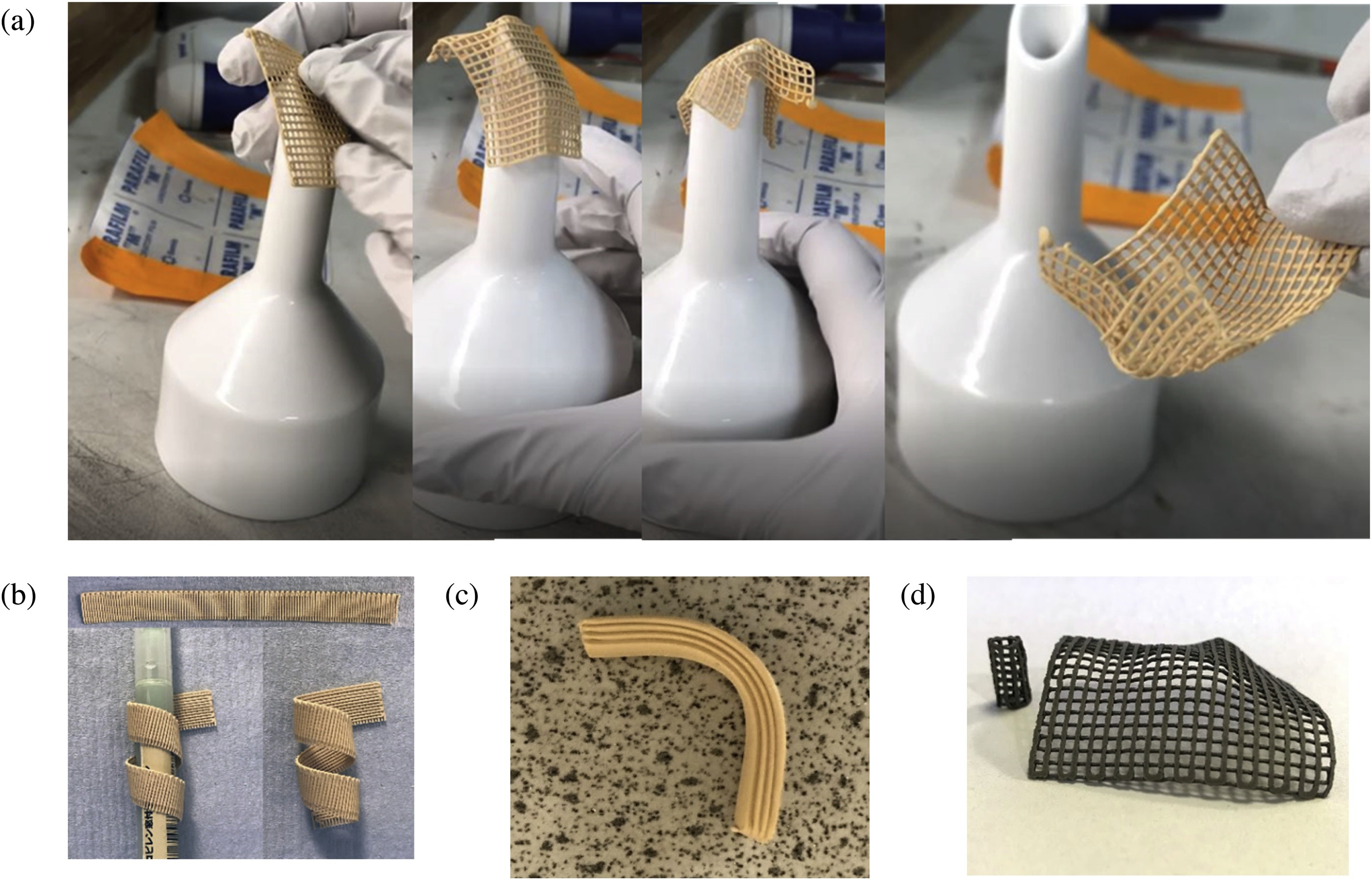 "An image from the journal paper Conformable green bodies: Plastic forming of robocasted advanced ceramics - ""Showcase of the conformability of the printed parts - Al2O3 nets moulded against sharp (a) and rounded (b) objects after 7 -h air-drying, Al2O3 bar bent after 18 -h air-drying (c), α-SiC/B4C nets shaped after 10-minute air-drying (d)."" from the journal paper Conformable green bodies: Plastic forming of robocasted advanced ceramics"