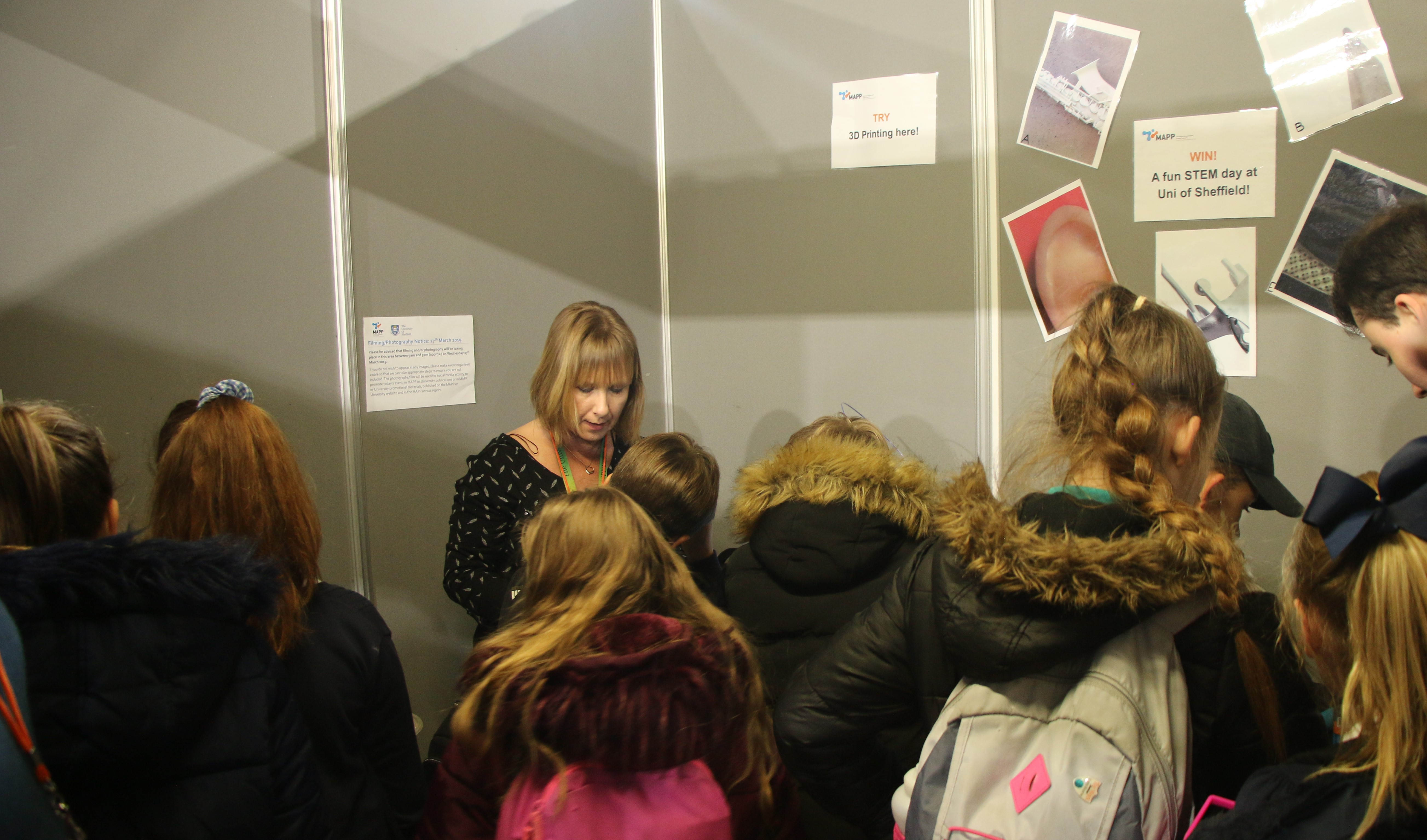 Project manager Karen Wood speaks to young people at MAPP's busy stand at the Get Up to Speed event